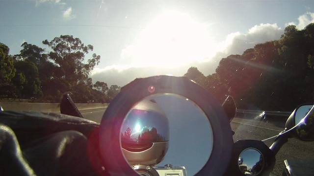 100828 160 030 tt blue face shield reflect sun trees in mirror