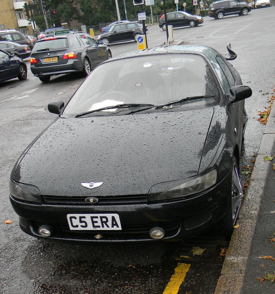 Toyota Sera Black Sports Car Illegally Parked Sutton Court