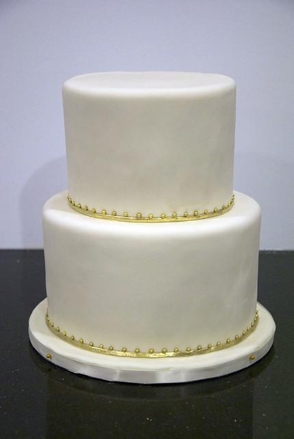 simple ivory gold wedding cake