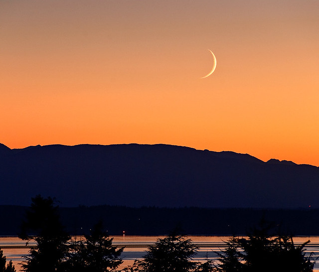 Olympics + crescent moon setting