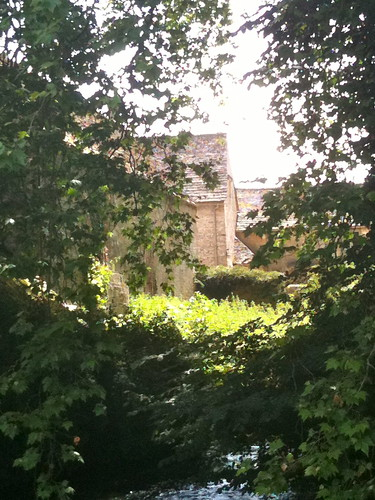 Through the foilage at Bibury Mill | by Tip Tours
