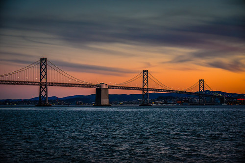 sanfrancisco california unitedstates us bay bridge sunset viewed from treasure island san francisco ca water sf orange sun bro brücke puente pont ponte brug bouwwerk most brig köprü bur broen calif ocean pacific dusk
