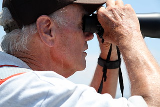 Frank Bowers, Retired USFWS Oil Spill Responder, scans for oiled birds
