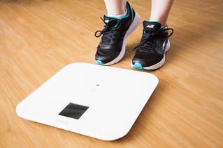 person about to stand on weighing digital scale | by franchiseopportunitiesphotos