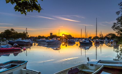 stour river sun sunrise christchurch boat priory reflection flare