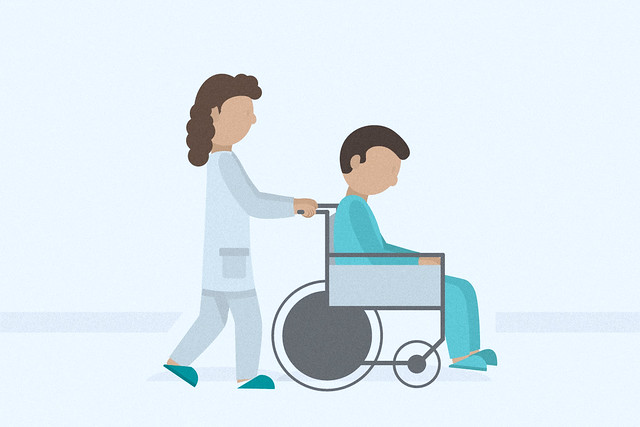 nurse pushing a patient in a wheelchair