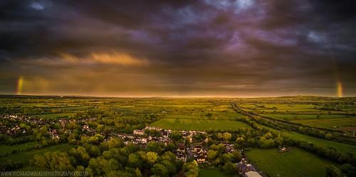 landscape clouds rainbow drone
