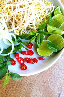 Vietnamese beef pho rice noodle broth #chilli #lime #mint #vietnamese   by michtsang