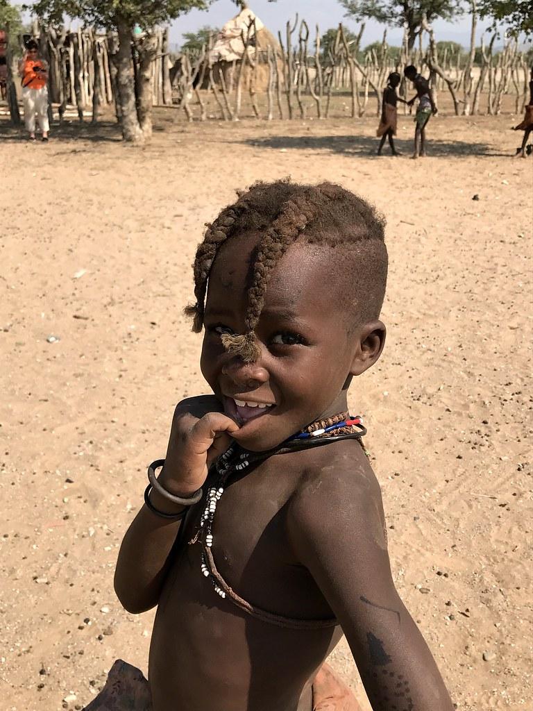 Himba child - in an Opuwo Kaokoland village, Namibia.