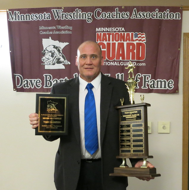 Principal Jerry Reker of Kasson-Mantorville accepted the MWCA Class AA Individual State Tournament Team Champion Award.