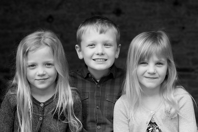 Beautiful young siblings pictured in soft black and white.