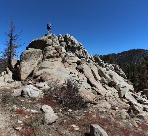 0434 Vicki climbs up on a rocky crag to survey the burnt zone from the Lake Fire | by _JFR_