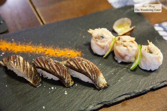 Plate of blowtorched sardine nigiri with togarashi and clam & sea bass maki