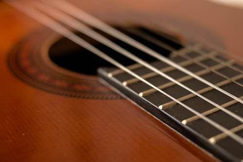 closeup shot of guitar and strings | by wuestenigel