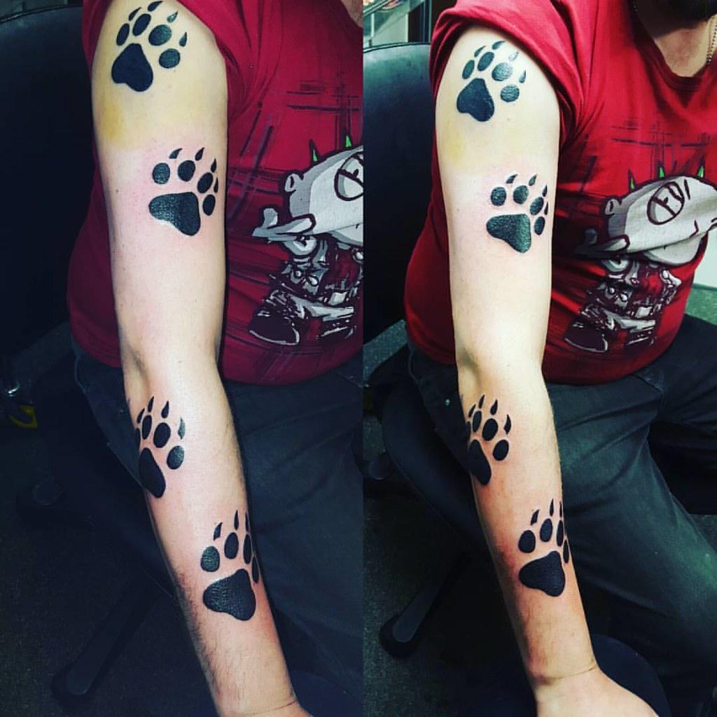 Bear paw prints tattoo by Sean at www adventuretattoos com