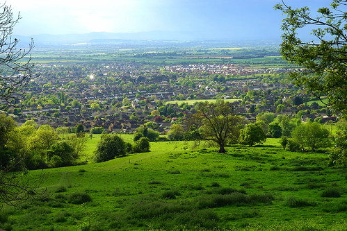 sun hill cleevehill cotwolds risingsuninn bishopscleeve malvernhills countryside country cheltenham england view panorama field fields hedges green uk unitedkingdom english britain british evening vale glos slope town houses oldenglishinns