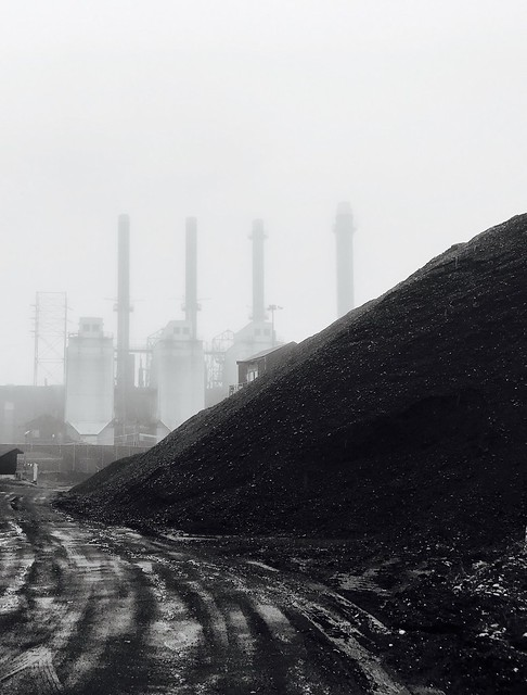 Coal burning plant in fog