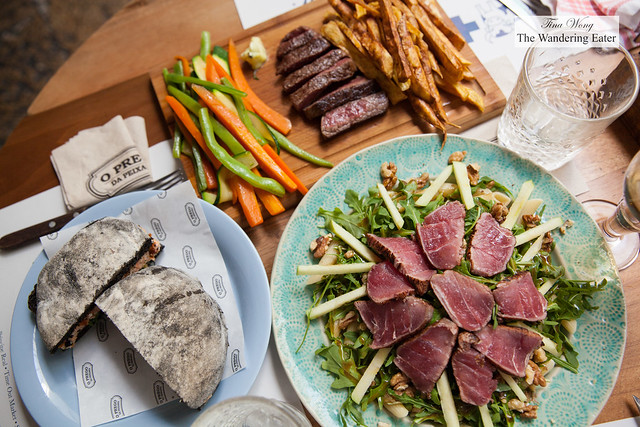 Lunch spread - Tuna salad, Salmon & Cuttlefish burger in squid ink bread, Seared Wagyu steak with sauteed vegetables and sweet potato fries