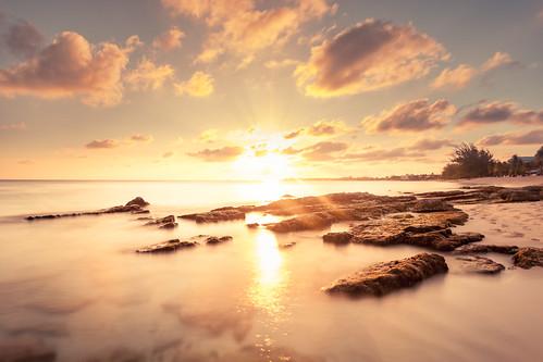 sunset longexposure sea ocean grandcayman caymanislands shore landscape seascape outdoor sevenmilebeach westbay