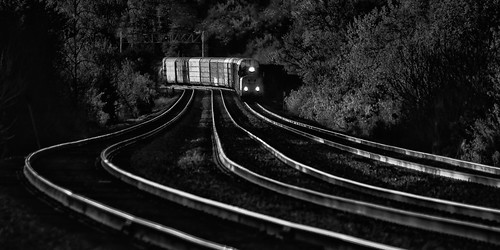 freighttrain unionpacificrailroad uprr genevasubdivision winfieldillinois dupagecounty chicagoland traintracks rails curves curvy monochrome suburban transportation landscape locomotive autoracks morning dawn sunrise headlights reflections spring may woods foliage trees blackandwhite moody converginglines approachingtrain nikond5100 tamron18270 lightroom5 photoshopbyfehlfarben thanksbine shadows steel ribbons signal semaphore lowkey curvytracks16jpg vanishingpoint