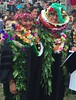 Graduates are honored with lei as commencement ends in a huge crowd that covers the grassy Andrews Amphitheater on May 14, 2017. Photos by Spencer Kimura and Mike Orbito