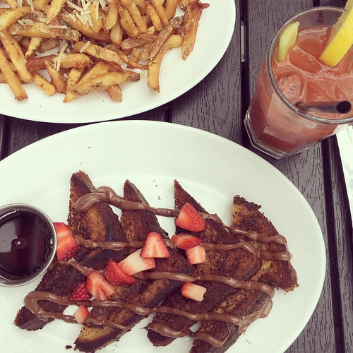 Brunch done right. Brioche French toast with Nutella, maple syrup, and fresh strawberries, along with some Bloody Mary and truffle fries! | by Sonara Arnav
