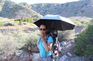 1202 Vicki has her chrome umbrella deployed on her backpack and is ready to hike in the sun | by _JFR_