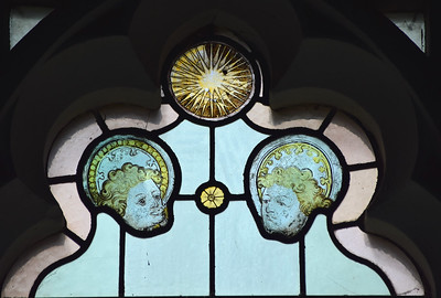two angel heads, the sun and a primrose (15th Century)