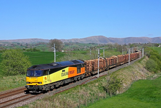 Colas Rail 60087 passes Docker, WCML south of Tebay on 3.5.17 with 6J37 1157 Carlisle Yard Colas Rail - Chirk Kronospan log train under a cloudless sky