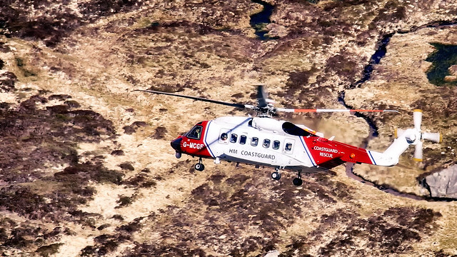 HM Coastguard helicopter in Cairngorms National Park