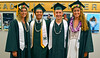 Swimming and diving graduates Morgan Mark, Tyler Yee, Karl Hannebach and Cherelle Oestringer at UH Manoa's spring 2017 commencement ceremony at the Stan Sheriff Center on Saturday, May 13, 2017.