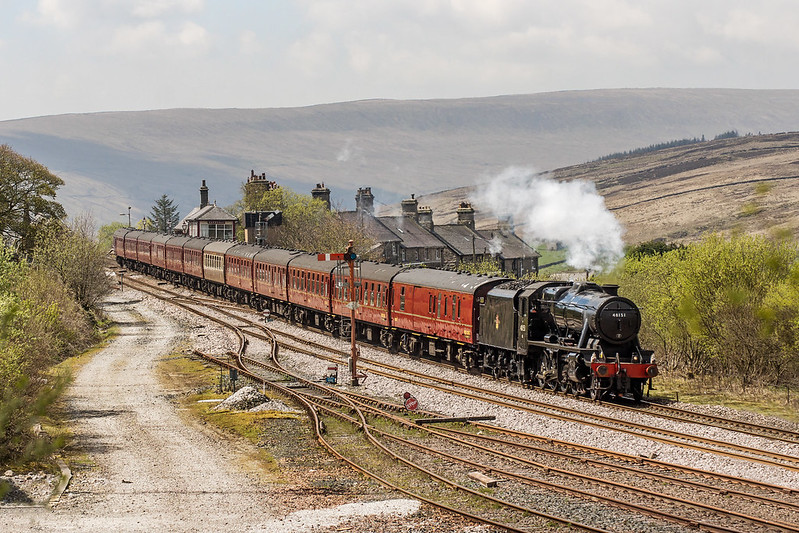 Stanier '8F' 2-8-0 No.48151 makes its return to the Midland Route heading the 1Z47 06:25 Kidderminster to Carlisle 'Pendle Dalesman' romping through Garsdale station on Wednesday 10th May 2017.  Copyright Gordon Edgar  - All rights reserved. Please do not use any of these images without my explicit permission