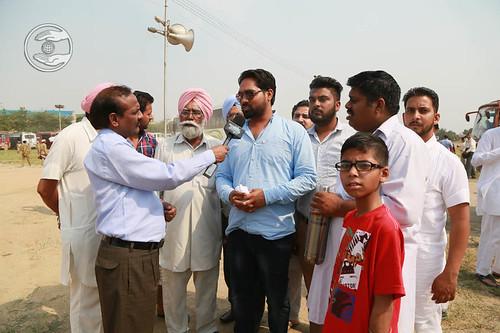 Devotees speaking with media