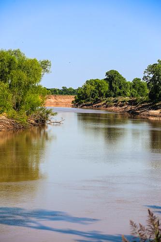 texas washintoncounty wallercounty brazosriver armsofgod river history legend navigable stream banks fields trees water muddywater flow wyojones np