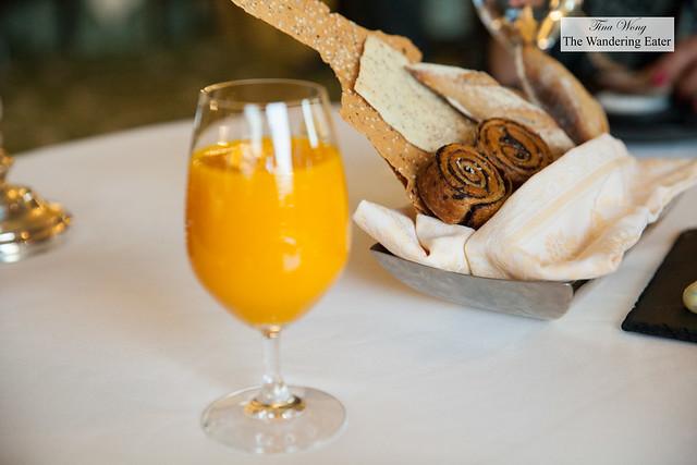 Mango juice and bread basket