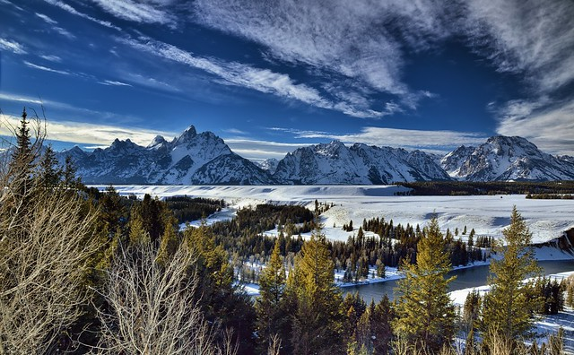Blue Skies and Clouds Above to Take in A Wintry Wonderland of the Tetons