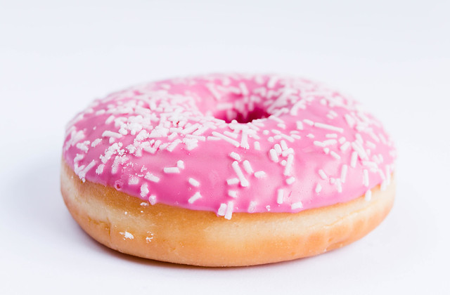Pink donut with white sprinkles
