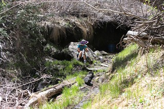0490 Vicki filtering water at Mission Springs - the spring is under that dark overhang   by _JFR_