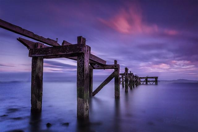 Sunset over HawkCraig Pier, Aberdour, Scotland.