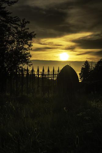 sunset silhouette churchyard cemetary gravestones