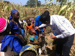 Administering vaccine on a farm in Nigeria   by CDC Global Health