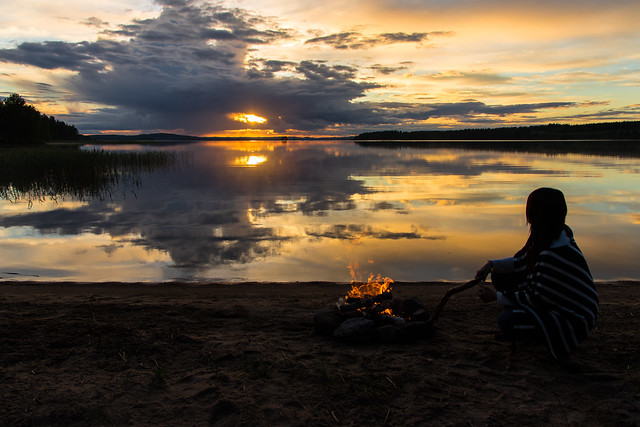 woman and a campfire