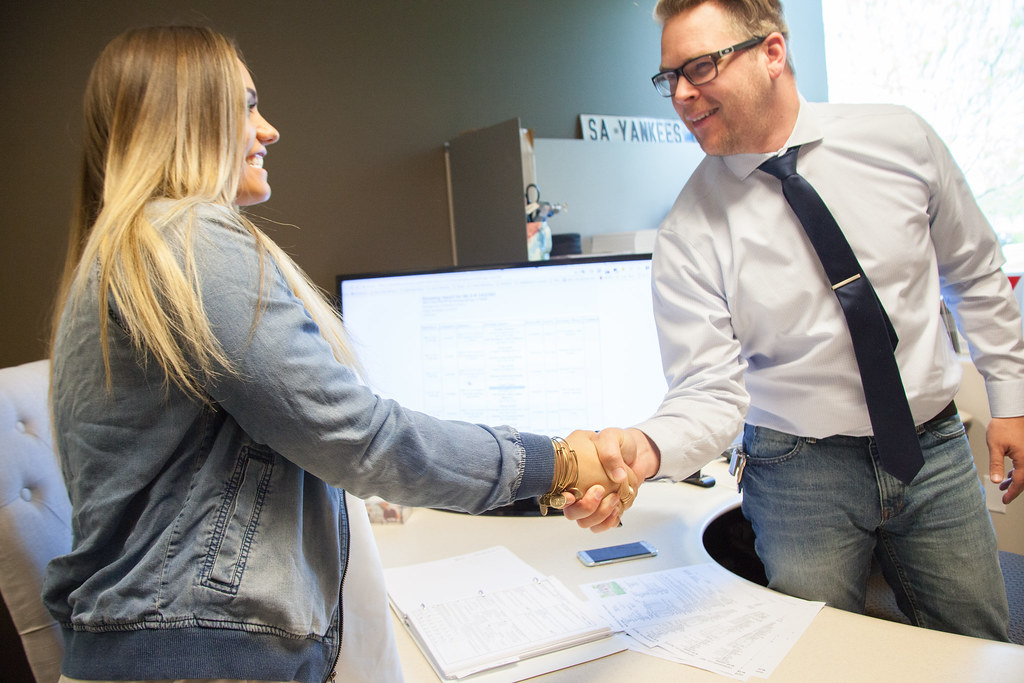 insurance agent and client shaking hands
