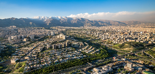 city capital tehran iran mountain snow sunset highway trafic building milad tower panoramic