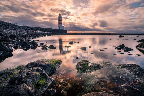 lighthouse landscape sunset gardur nature reflection rocks outdoor iceland water travel sea garður southernpeninsularegion is onsale