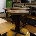 Small dark wood circular table E40