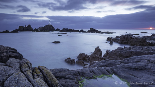 serene sea seascape sundown sunset coast lighthouse jersey ocean englishchannel rock rockpool leefilters longexposure