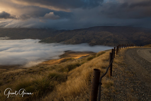 dawn sunrise mountains cloud sun hills grass curves mist highlight landscape fence goldenhour golden