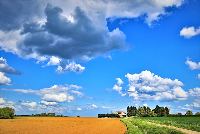 Clouds gathering over isolated farmland