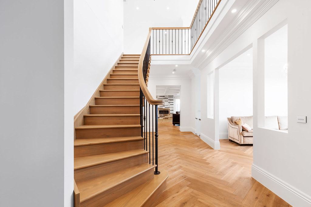 Modern Twist On Traditional Stair With Continuous Handrails
